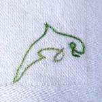 dauphin minimaliste brodé en fil dégradé vert